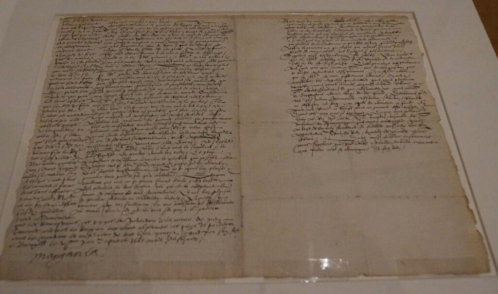 Het smeekschrift der edelen met Margaretha's belofte links in de kantlijn.