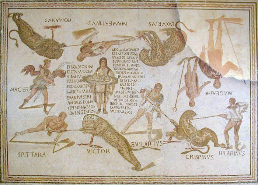 Bron: Musée de Sousse. Mozaïekvloer uit Smirat in huidig Tunesië, ca 225-250 n. Chr. Te zien is de strijd tussen vier luipaarden en vier venatores van de Telegenii, daarnaast zijn de goden Diana en Dionysos en waarschijnlijk Magerius, die het schouwspel bekostigd heeft, en een bediende met vier geldzakken afgebeeld.