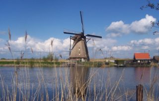 Lijst van Werelderfgoederen in Nederland (UNESCO) - Een van de negentien Kinderdijkse molens (cc)