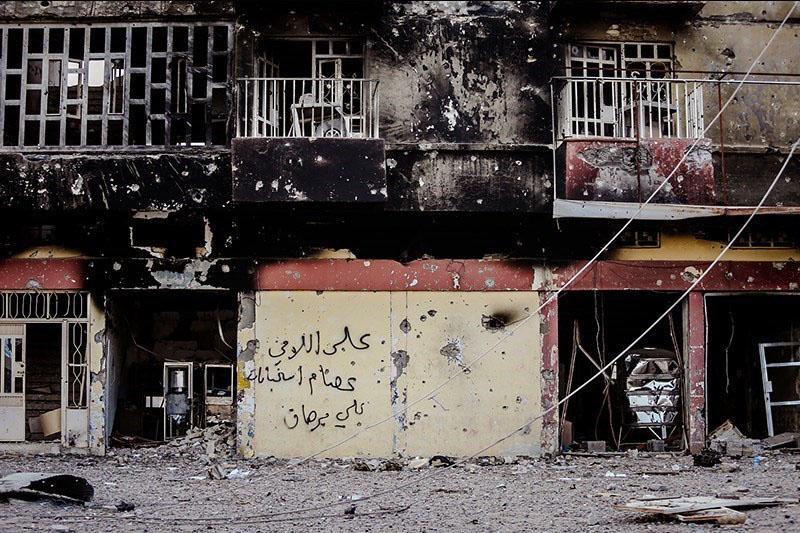Graffiti op een muur in Fallujah - cc