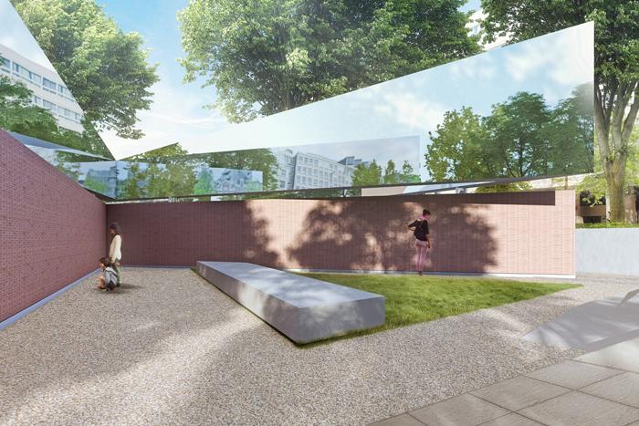 Zijaanzicht van het monument met de muren van baksteen. Op iedere steen staat een naam van een slachtoffer. (holocaustnamenmonument.nl)