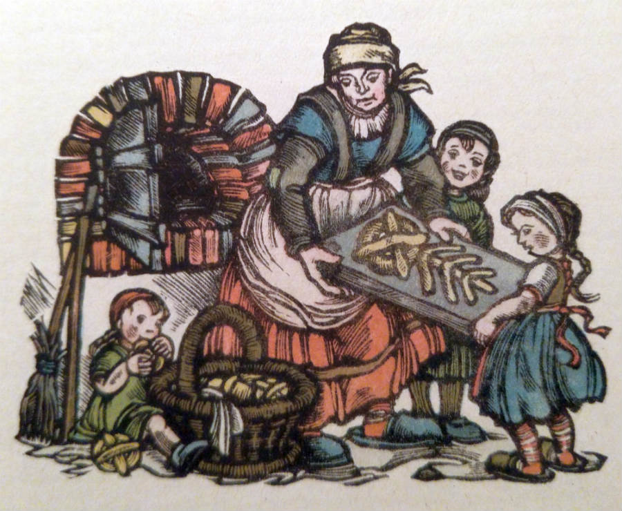 Voorbereidingen voor kerst: een moeder bakt lekkernijen in Germaanse vormen. (Collectie auteur)