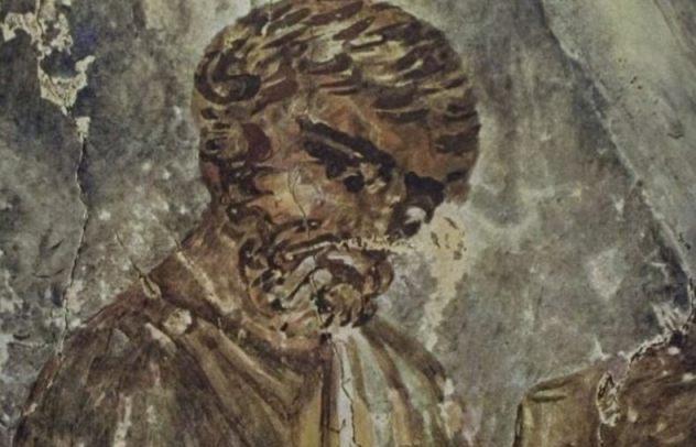 Schriftgeleerde met boekrol (Catacombe van Petrus en Marcellus, Rome)
