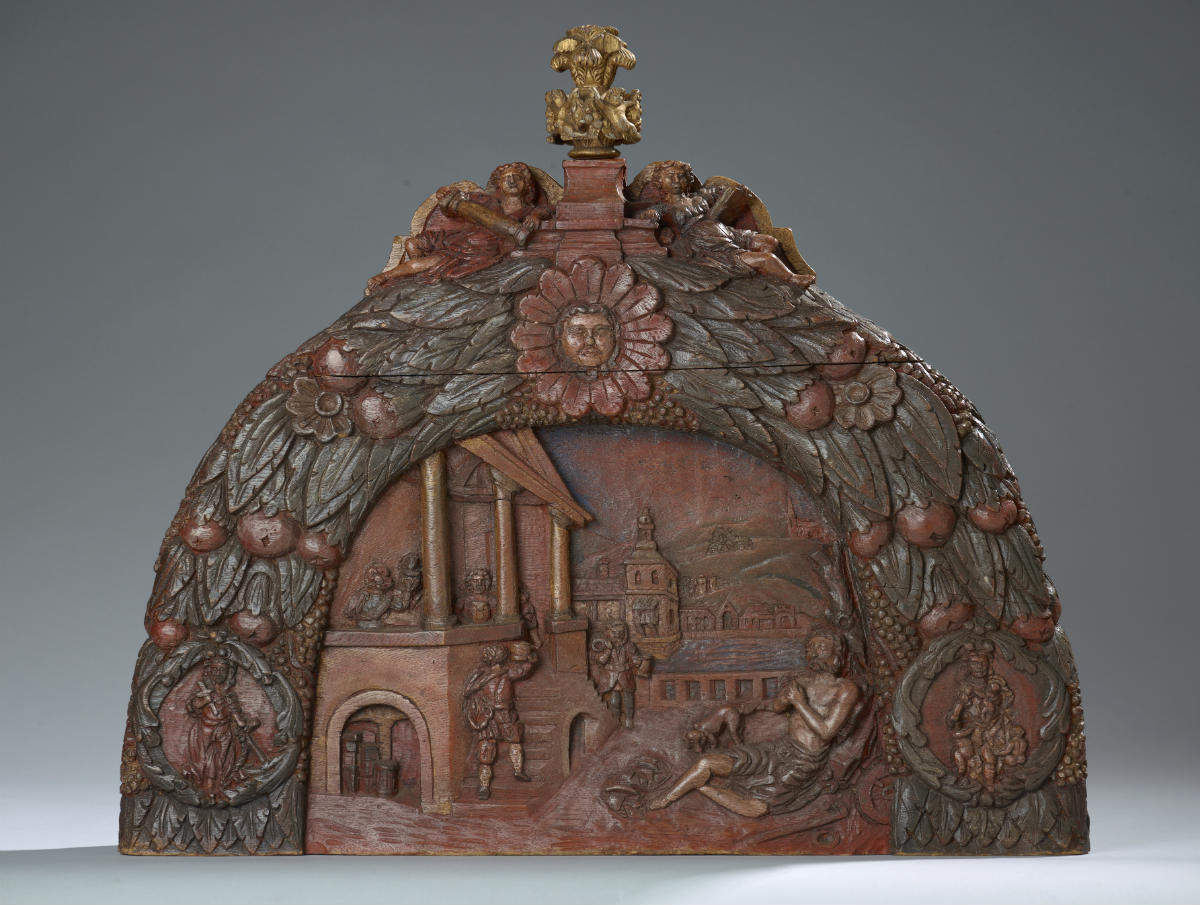 Hakkebord met een voorstelling van de rijke man en de bedelaar Lazarus, eikenhout, Nederland, 18de eeuw. Collectie Het Scheepvaartmuseum.