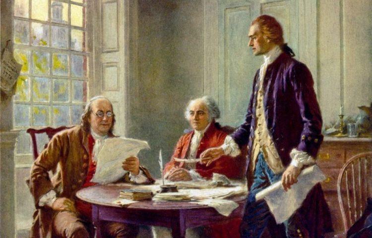 Benjamin Franklin, John Adams (midden) en Thomas Jefferson werken aan de Amerikaanse Onafhankelijkheidsverklaring (Publiek Domein - wiki)