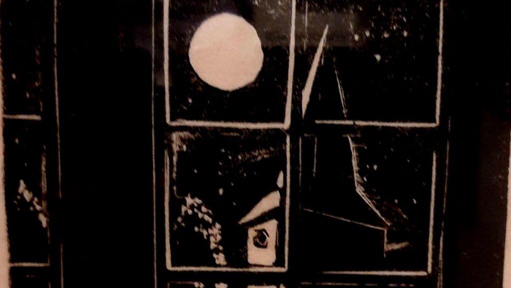 Kerk van Putten - Detail van een houtsnede van Jo Bezaan over de razzia van Putten (foto Historiek)