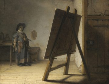 De jonge kunstenaar in zijn atelier