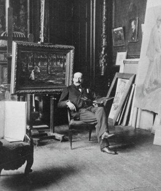 Max Liebermann in zijn atelier in Berlijn - Op de achtergrond het schilderij Naar school in Laren, 1898