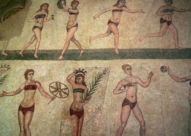Fresco van de Biki-meisjes in Piazza Armerina op Sicilië (Afbeelding boek)
