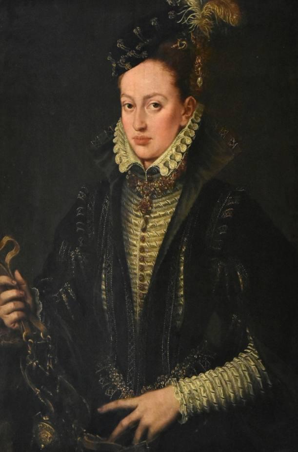 Vermoedelijk portret van Margaretha van Parma - Alonso Sánchez Coello (Publiek Domein - wiki, Koninklijk Museum voor Schone Kunsten Brussel) - Margaretha van Parma, een halfzus van Filips II, was de landvoogdes der Nederlanden tussen 1559 en 1567. De kleding gedragen aan haar hof was beeldbepalend voor de mode in de Nederlanden.