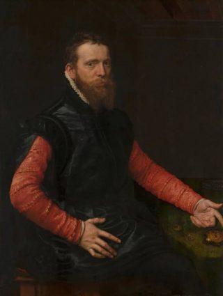 Portret Steven van Herwijck - Anthonis Mor van Dashorst, 1564 (Publiek Domein - wiki - Mauritshuis) - Steven van Herwijck, goudsmid, draagt een donkere paltrock met hoge kraag, over een rood wambuis. De mouwen van de paltrock zijn hoog ingesneden en hangen ongebruikt neer. Zijn hemd is nog zichtbaar bij de mouwen en in het gesmokte kraagje in de hals. Het korte haar met baard en snor zijn exemplarisch voor het modebeeld.