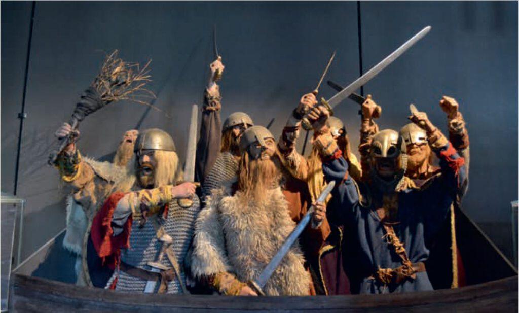 Noorse zelfspot: woeste Vikingen, klaar voor de aanval. Arkeologisk museum i Stavanger, foto H.M.D. Dekker; afb. uit Vikingen.